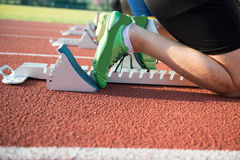 Feet on starting block ready for a spring start. Stock Photos