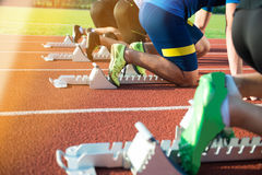 Feet on starting block ready for a spring start. Stock Photo