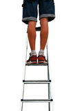 Feet on steel ladder Royalty Free Stock Images