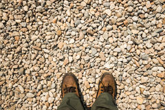 Feet step on gravel background Royalty Free Stock Images