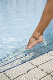 Feet Step Into The Swimming Pool Royalty Free Stock Images