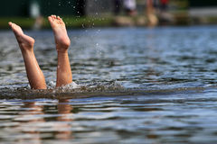 Feet sticking out of water Royalty Free Stock Images