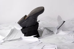 Feet stikking out of papers Royalty Free Stock Photo