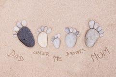 Feet by stones - family Royalty Free Stock Photos