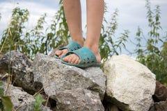 Feet on stones Stock Image