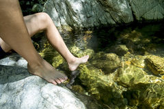 Feet in a stream Stock Photography