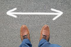 Feet on the street with arrows Royalty Free Stock Photography