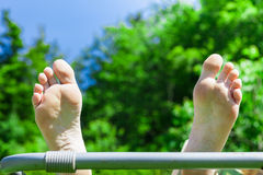 Feet are stretched in the air Royalty Free Stock Photos