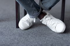 Feet in stylish white shoes Royalty Free Stock Image