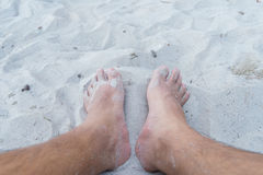 Feet on the summer beach Stock Photography