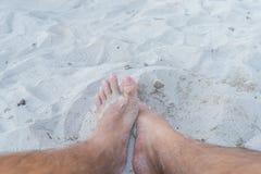 Feet on the summer beach Stock Photo