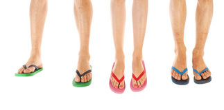 Feet in summer flip flops Stock Photography