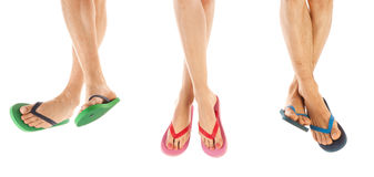 Feet in summer flip flops. Many feet in colorful summer flip flops Royalty Free Stock Photography