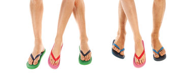 Feet in summer flip flops. Many feet in colorful summer flip flops stock photo