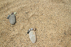 Feet on the sunny beach Royalty Free Stock Photo