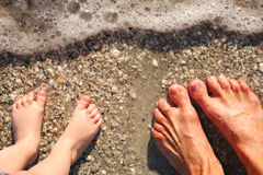 Feet in surf Royalty Free Stock Image