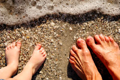Feet in surf. At beach Royalty Free Stock Images