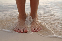 Feet in the Surf Stock Photo