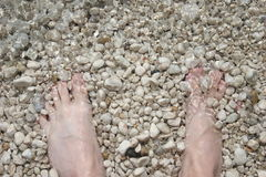 Feet in surf Stock Photo