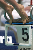 Feet swim start. Feet leave the blocks at the start of a swimming race Stock Photography