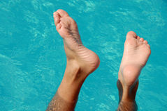 Feet in swimming pool Royalty Free Stock Images
