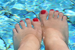 Feet in the swimming pool Royalty Free Stock Images