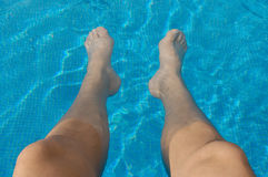 Feet in a swimming pool stock photos