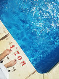 Feet by the swimming pool Stock Photo