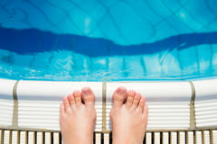 Feet at the swimming pool Royalty Free Stock Photo