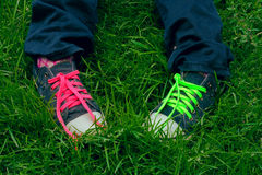 Feet teen in sneakers. With colored laces Stock Images