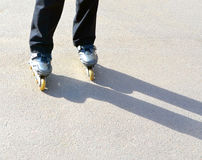 Feet of the teenager skating on roller-skates Royalty Free Stock Photos