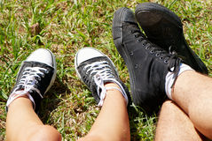 Feet of  teenagers and gym shoes Stock Photography
