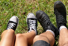 Feet of  teenagers and gym shoes Royalty Free Stock Images