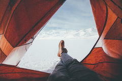 Feet through tent in mountains Stock Image
