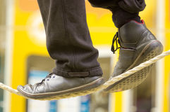 The feet of a tightrope walker Royalty Free Stock Photos