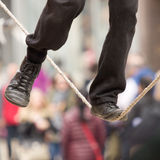 The feet of a tightrope walker Stock Photos