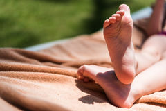 Feet of toddler on beach Royalty Free Stock Photography