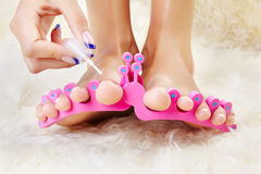Feet in toe separators Stock Photography