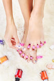 Feet in toe separators Royalty Free Stock Images