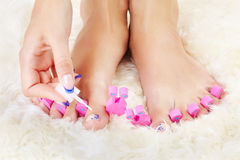 Feet in toe separators Stock Photo