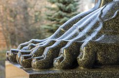Feet of granite atlantes in the hermitage of St. Petersburg in R Stock Photo