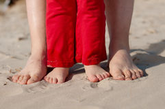 Feet and toes. In the sand royalty free stock image