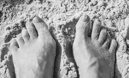 Feet and Toes in the Sand on a Beach Stock Photo