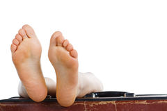 Feet on top of suitcase Stock Photography