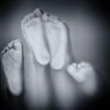 Feet touching glass Stock Photos