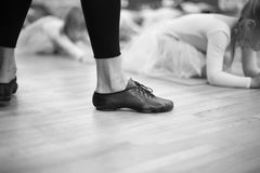 Feet of trainer in ballet school for small girs Royalty Free Stock Photography