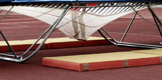 Feet in trampoline webbing Royalty Free Stock Photos