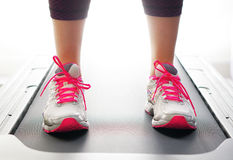 Feet on treadmill with bright shoes. Feet on treadmill bright shoes Stock Images