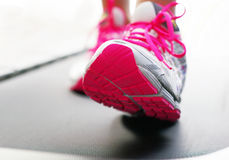 Feet on treadmill with bright shoes. Feet on treadmill bright shoes Royalty Free Stock Photos