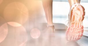 Feet on treadmill and peach bokeh transition Royalty Free Stock Images